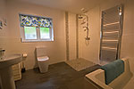 downstairs bathroom with wetroom shower and bath
