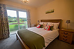 double bedroom downstairs with country views